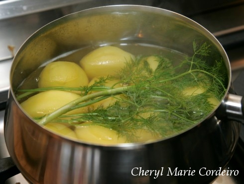 In the pot, boiled potatoes and dill for a Swedish Midsummer meal.