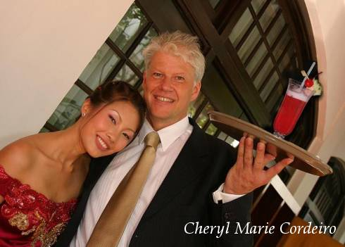 Cheryl Marie Cordeiro and Jan-Erik Nilsson, Raffles Hotel, Singapore with the Singapore Sling, outside East India Room.